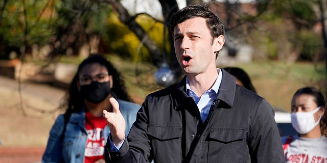 Jon Ossoff speaking after voting early in Atlanta on Dec. 22.
