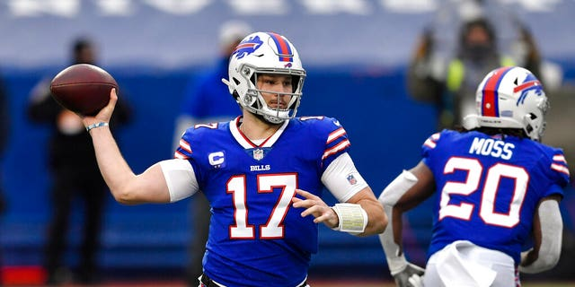 Buffalo Bills quarterback Josh Allen passes in the first half of an NFL football game against the Miami Dolphins, Jan. 3, in Orchard Park, N.Y. (AP Photo/Adrian Kraus)