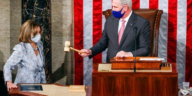 House Minority Leader Kevin McCarthy, R-Calif., gavels in House Speaker Nancy Pelosi, D-Calif., during opening day of the 117th Congress at the U.S. Capitol in Washington, Sunday, Jan. 3, 2021. (Tasos Katopodis/Pool via AP)