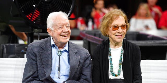 Former President Jimmy Carter and Rosalynn Carter are seen ahead of an NFL football game between the Atlanta Falcons and the Cincinnati Bengals, in Atlanta, in this file photo.
