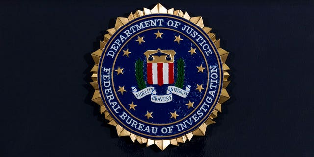 The FBI seal is seen before a news conference at FBI headquarters in Washington.