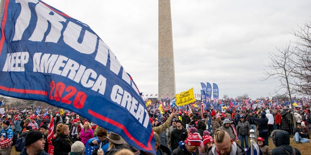 With the Washington Monument in the background, people attend a rally in support of President Donald Trump on Wednesday, Jan. 6, 2021, in Washington. (AP Photo/Jose Luis Magana)