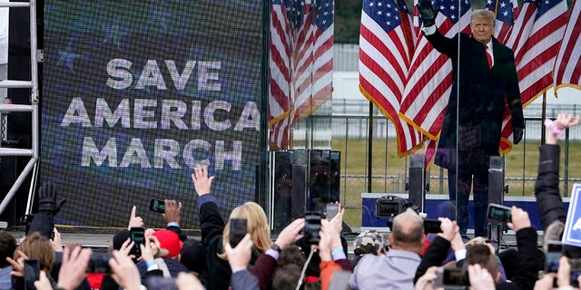 """President Donald Trump arrives to speak at a rally Wednesday, Jan.. 6, 2021, in Washington. Shortly after, a pro-Trump mob stormed the U.S. Kapitool, forcing lawmakers and Vice President Pence into hiding. Federal prosecutors said Trump's supporters aimed to """"capture and assassinate"""" elected officials. (AP Photo/Jacquelyn Martin)"""