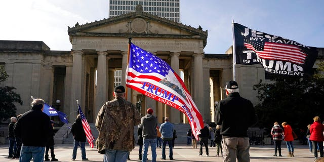 People take part in a rally at the Legislative Plaza, Jan. 6, in Nashville, Tenn.