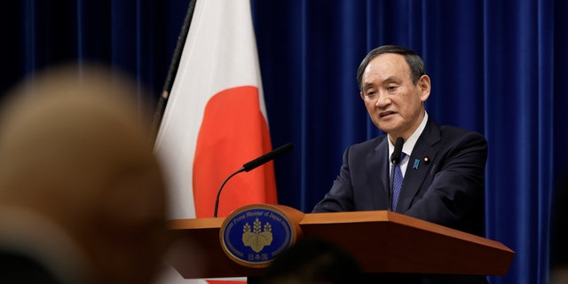Japan's Prime Minister Yoshihide Suga speaks during a news conference at the prime minister's official residence in Tokyo, Thursday, Jan. 7, 2021. (Kiyoshi Ota/Pool Photo via AP)