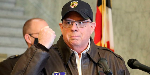 Maryland Gov. Larry Hogan holds his hand up during a news conference in Annapolis, Md., on Thursday, Jan. 7, 2021, as he describes phone conversations he had with Maryland Rep. Steny Hoyer and Secretary of the Army Ryan McCarthy on sending Maryland National Guard members to help protect the U.S. Capitol after rioters stormed the building a day earlier. (AP Photo/Brian Witte)