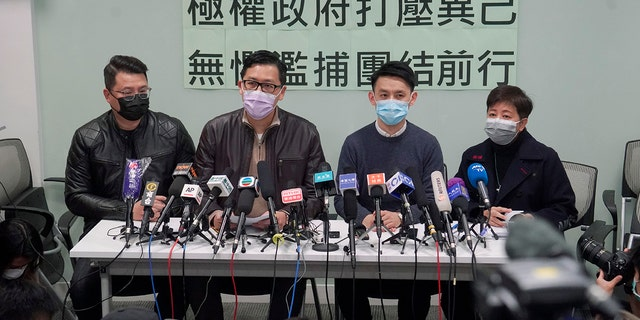 Former Democratic Party legislators Andrew Wan, left, Lam Cheuk-ting, second left, and Helena Wong, right, attend a press conference after being released on bail in Hong Kong, Friday, Jan. 8, 2021. (AP Photo/Kin Cheung)