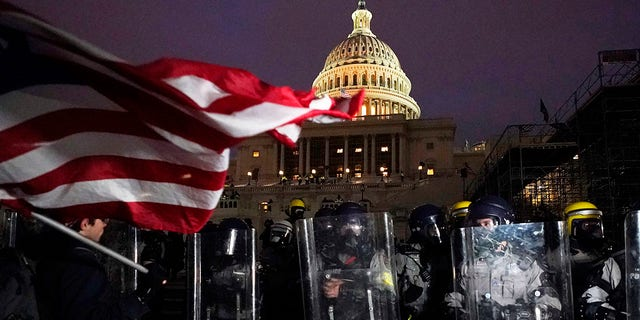 Police stand guard after a day of riots at the U.S. Capitol in Washington on Wednesday, Jan. 6, 2021. (Associated Press)