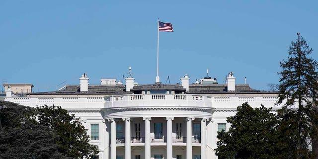 An American flag flies above the White House in Washington, Jan. 9. (AP Photo/Patrick Semansky)