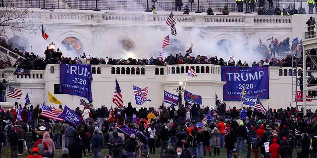 Violent protesters, loyal to President Donald Trump, storm the Capitol, in Washington, D.C., on Jan. 6, 2021. (AP Photo/John Minchillo, File)