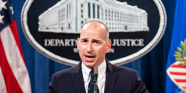 Acting U.S. Attorney Michael Sherwin speaks during a news conference Tuesday, Jan. 12, 2021, a Washington.