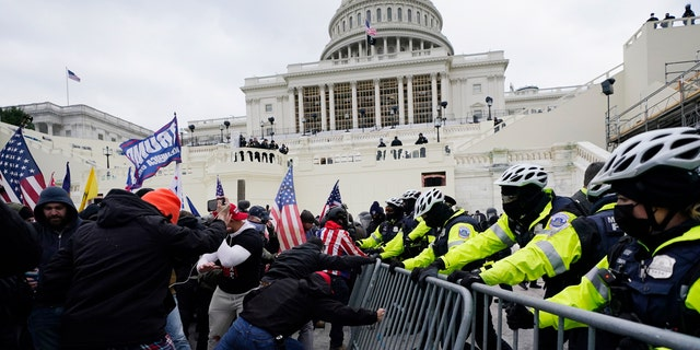President Trump supporters try to break through a police barrier at the Capitol in Washington, D.C., on Jan. 6, 2021. (AP Photo/Julio Cortez, File)