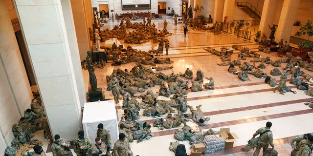Hundreds of National Guard troops inside the Capitol on Wednesday, Jan. 13, 2021. (AP Photo/J. Scott Applewhite)