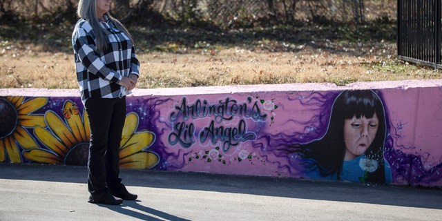 Donna Williams waits to approach the podium, Wednesday, Jan. 13, 2021, in Arlington, Texas, to speak on the 25th anniversary of the abduction and subsequent murder of her daughter, Amber Hagerman, depicted in the mural on the right. (Associated Press)