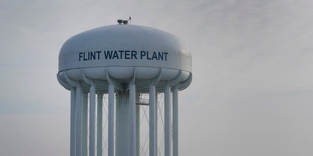 The Flint Water Plant tower is shown in Flint, Mich., Some Flint residents impacted by months of lead-tainted water are looking past expected charges against former Gov. Rick Snyder and others in his administration to healing physical and emotional damages left by the crisis. (AP Photo/Paul Sancya)