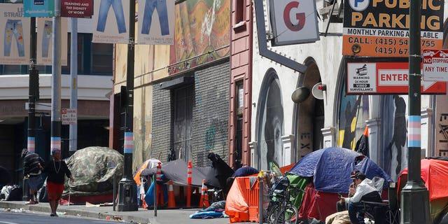 FILE: Tents line a sidewalk on Golden Gate Avenue in San Francisco.
