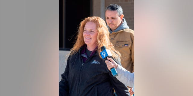 Jenny Cudd, front, a flower shop owner and former Midland mayoral candidate, and Eliel Rosa leave the federal courthouse in Midland, Texas, Wednesday, Jan. 13, 2021. (Tim Fischer/Reporter-Telegram via AP)