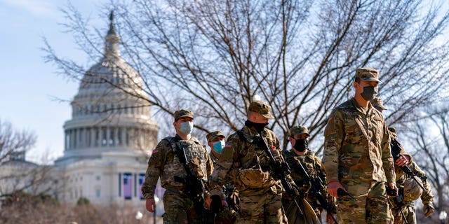 Members of the National Guard patrol outside the Capitol Building on Capitol Hill in Washington, Jan. 14. (AP Photo/Andrew Harnik)