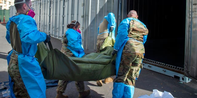 The LA County Dept. of Medical Examiner-Coroner shows National Guard members assisting with processing COVID-19 deaths and placing them into temporary storage at LA County Medical Examiner-Coroner Office in Los Angeles in Los Angeles.
