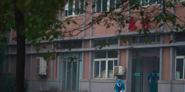 FILE: Hospital staff wash the emergency entrance of Wuhan Medical Treatment Center, where some infected with a new virus are being treated, in Wuhan, China.