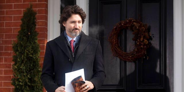 Canadian Prime Minister Justin Trudeau walks to the podium from Rideau cottage for a news conference, Tuesday, Jan. 19, 2021, in Ottawa, Ontario.