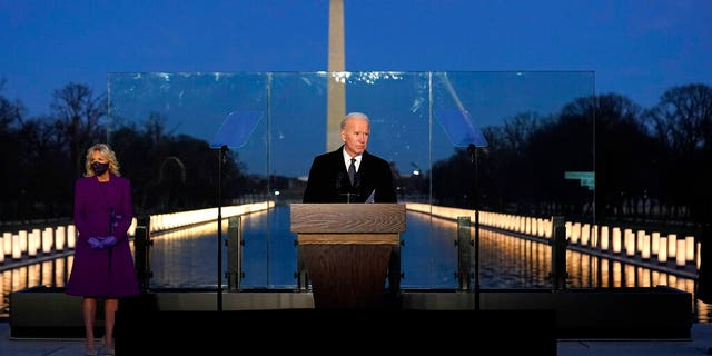 President-elect Joe Biden speaks during a COVID-19 memorial, with lights placed around the Lincoln Memorial Reflecting Pool, Tuesday, Jan. 19, 2021, in Washington. (AP Photo/Alex Brandon)