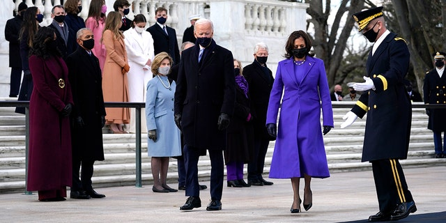 President Joe Biden and Vice President Kamala Harris arrive at the Tomb of the Unknown Soldier at Arlington National Cemetery during Inauguration Day ceremonies in Arlington, Va.  (AP Photo/Evan Vucci)