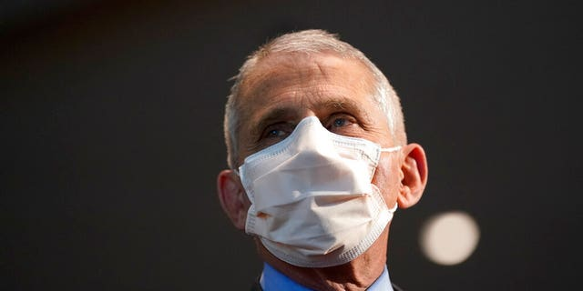 AP21021483935286 FAUCI UNMASKED: Top doctor under scrutiny after prescribing mixed messages on COVID-19, vaccines, reopenings Featured Top Stories U.S. [your]NEWS