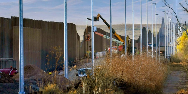 """FILE - Crew representatives will build part of the boundary wall in the San Bernardino National Wildlife Refuge on Tuesday, December 8, 2020 in Douglas, Ariz.  President Biden ordered on Wednesday """"break"""" to all wall structures within a week.  (AP Photo / Matt York)"""