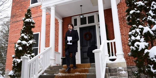 Prime Minister Justin Trudeau holds a press conference at Rideau Cottage in Ottawa on Friday, Jan. 22, 2021.During the press conference, Trudeau said his government is prepared to impose even stricter regulations on travel than the country already has in place.<br> (Sean Kilpatrick/The Canadian Press via AP)