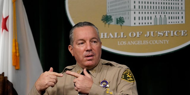 In this Sept. 17, 2020, file photo, Los Angeles County Sheriff Alex Villanueva comments on the shooting of 29-year-old Dijon Kizzee, who was killed by deputies following a scuffle, during a news conference at the Hall of Justice in downtown Los Angeles. The California Department of Justice has opened a civil rights investigation to determine whether the Los Angeles County Sheriff's Department has engaged in a pattern or practice of unconstitutional policing, California Attorney General Xavier Becerra announced Friday, Jan. 22, 2021. (AP Photo/Damian Dovarganes, File)