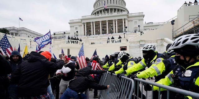 On Jan. 6, 2021, Trump supporters try to break through a police barrier at the Capitol in Washington. (AP Photo/Julio Cortez, File)
