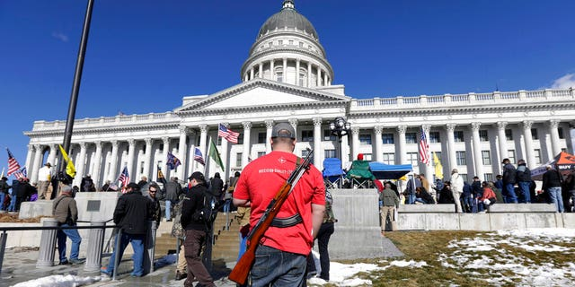 FILE: A man carries his weapon during a second amendment gun rally at Utah State Capitol on Feb. 8, 2020, in Salt Lake City.