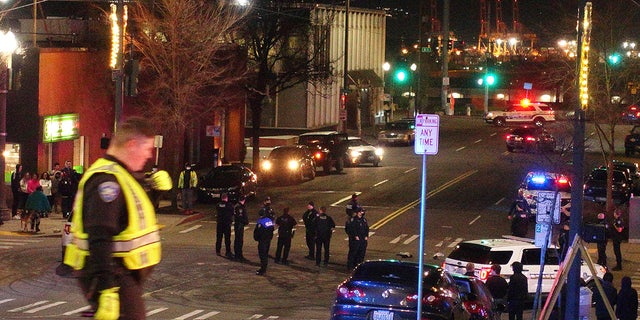 Tacoma police and other law enforcement vehicles are shown near the site of a car crash Saturday, Jan. 23, 2021, in downtown Tacoma, Wash. (Associated Press)