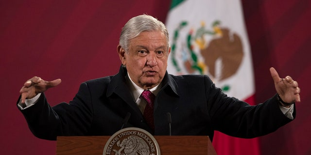 Mexican President Andres Manuel Lopez Obrador gives his daily, morning news conference at the presidential palace, Palacio Nacional, in Mexico City on Dec. 18, 2020. (AP Photo/Marco Ugarte, File)