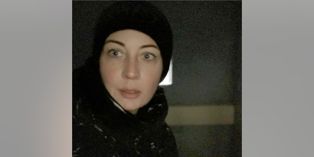 In this photo released by Yulia Navalny, wife of Russian opposition leader Alexei Navalny, in her Instagram account yulia_navalnaya, Yulia Navalnaya poses for a selfie inside a police bus after she was detained during a protest against the jailing of her husband in Moscow, Russia, Saturday, Jan. 23, 2021. (Yulia Navalny via AP)