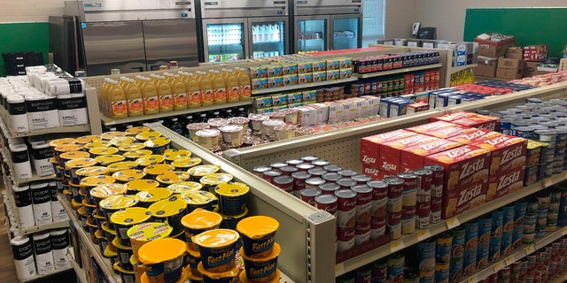 Food and toiletries line the shelves of Linda Tutt High School's student-led grocery store on Nov. 20, 2020, in Sanger, Texas. (Anthony Love via AP)