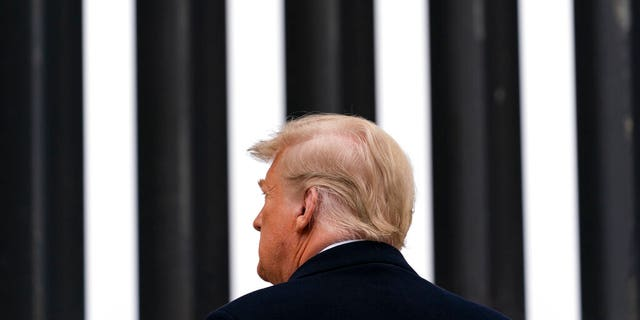 FILE: President Donald Trump tours a section of the U.S.-Mexico border wall in Alamo, Texas.