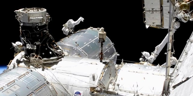 In this image taken from NASA video, NASA astronaut Mike Hopkins works outside the International Space Station's European lab on Wednesday, Jan. 27, 2021. (NASA via AP)
