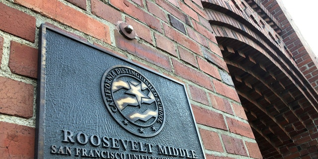 A plaque for Roosevelt Middle School is seen outside the school in San Francisco, on Wednesday, Jan. 27, 2021. (AP Photo/Haven Daley)