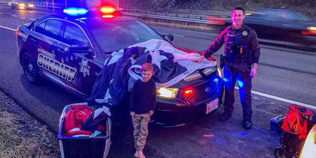 "Paul Veluscek drove across the U.S. with his brother and nephew, whose sixth birthday was on Jan. 6, to promote their ""Flag Called Freedom"" project."