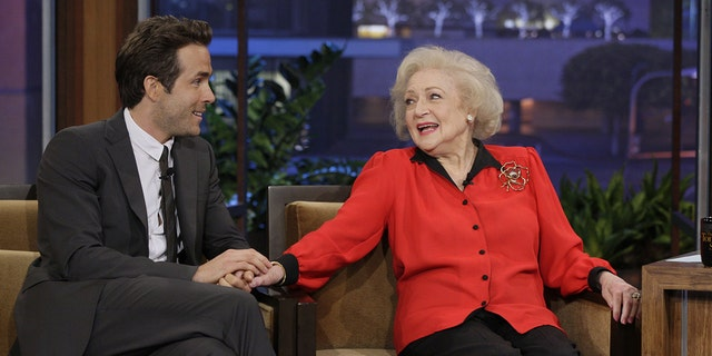 In the caption of his video, Reynolds (left) called his 'The Proposal' co-star Betty White (right) 'the funniest person on the planet.' Photo by: Paul Drinkwater/NBC/NBCU Photo Bank