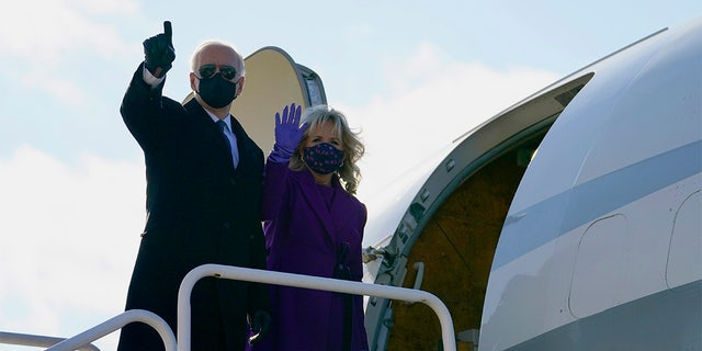 President-elect Joe Biden and his wife Jill Biden board a plane at New Castle Airport, Tuesday, Jan. 19, 2021, in New Castle, Del. (AP Photo/Evan Vucci)