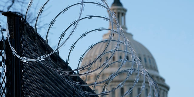 Razor wire is on top of security fencing that surrounds the U.S. Capitol in Washington, Monday, Jan. 18, 2021, ahead of the 59th Presidential Inauguration. (AP Photo/Susan Walsh)