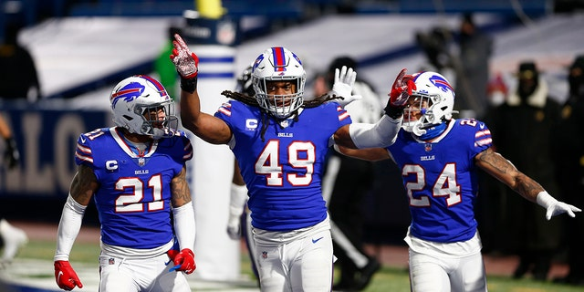Buffalo Bills middle linebacker Tremaine Edmunds (49) celebrates with Jordan Poyer (21) and Taron Johnson (24) during the second half of an NFL divisional round football game Saturday, Jan.. 16, 2021, in Orchard Park, N.Y.. The Bills won 17-3. (AP Photo/John Munson)