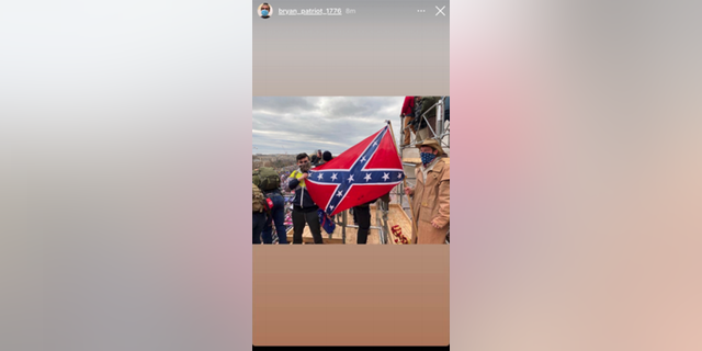 Bryan Betancur, left, posing with Confederate flag on Jan. 6 at the Capitol riot.