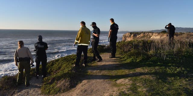Authorities look into the Pacific Ocean during a search for a California boy, 2, who was pulled under about 100 offshore.