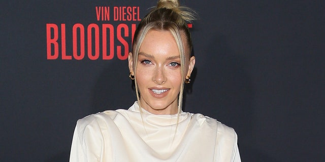 Camille Kostek posed in a Tampa Bay Buccaneers jersey with the number 87, which is worn by Gronkowski. (Photo by Jean Baptiste Lacroix/WireImage)