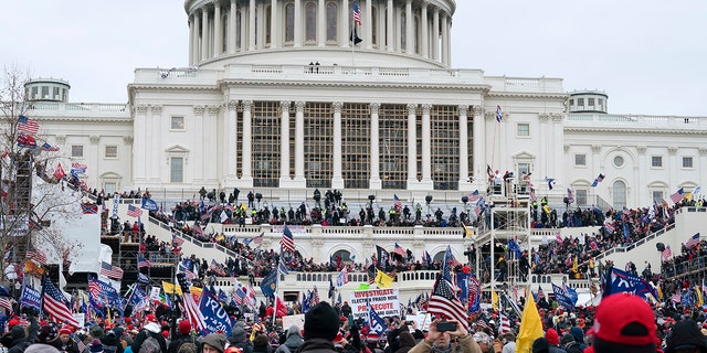 Trump supporters gather outside the Capitol, Wednesday, Jan. 6, 2021, in Washington. (AP Photo/Jose Luis Magana)