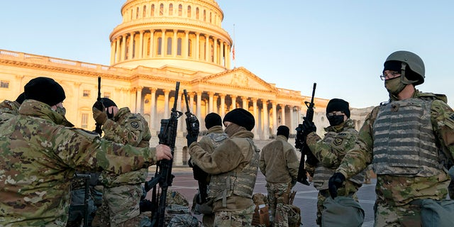 WASHINGTON, DC - JANUARY 13: Weapons are distributed to members of the National Guard outside the U.S. Capitol on January 13, 2021 in Washington, DC. Security has been increased throughout Washington following the breach of the U.S. Capitol last Wednesday, and leading up to the Presidential inauguration. (Photo by Stefani Reynolds/Getty Images)